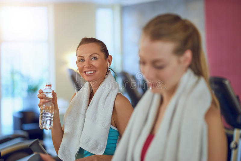 Healthy middle-aged woman drinking water royalty free stock images