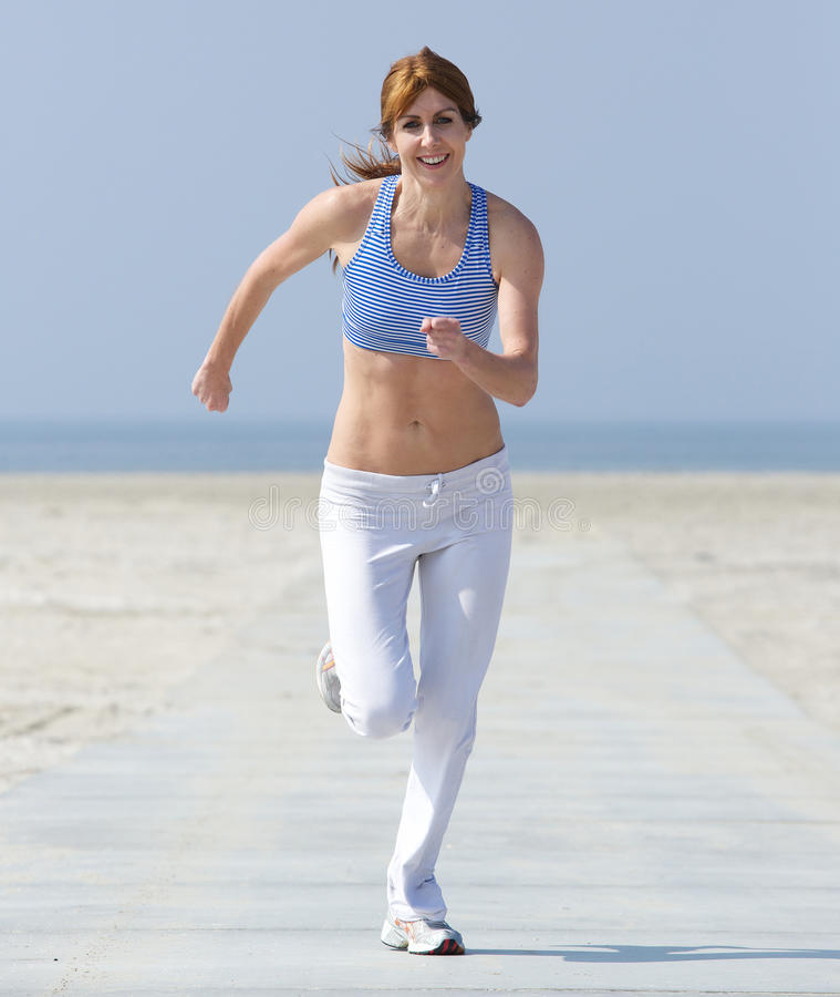 Free Healthy Middle Aged Woman Enjoying A Jog Stock Image - 40197841