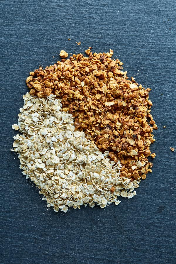 Healthy mix of granola and oatmeal on dark background, top view, close-up, selective focus royalty free stock photography