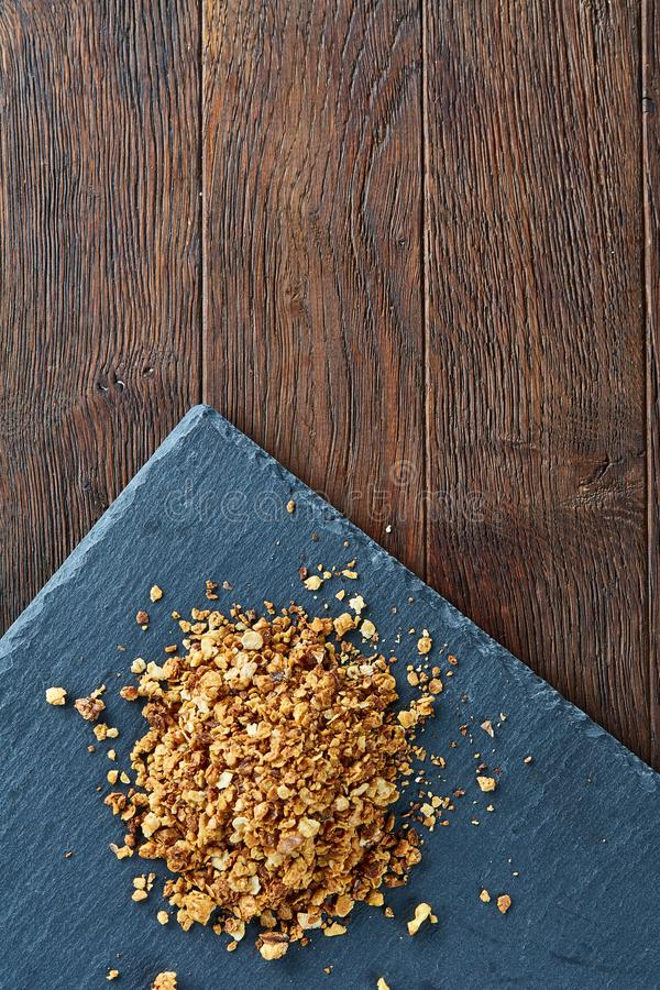Healthy mix of granola and oatmeal on dark background, top view, close-up, selective focus royalty free stock photos