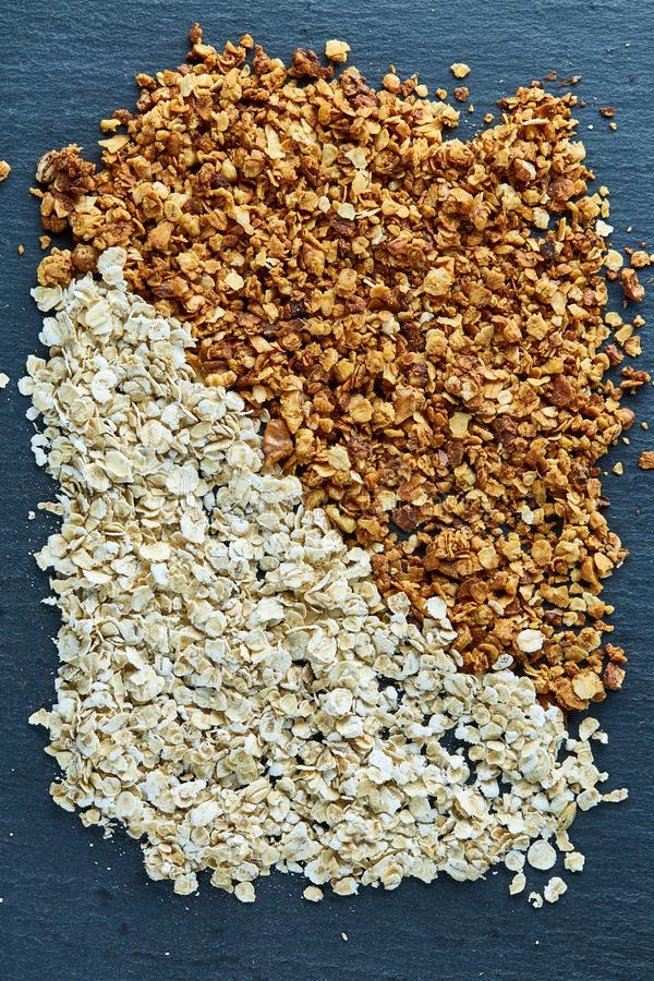 Healthy mix of granola and oatmeal on dark background, top view, close-up, selective focus stock image