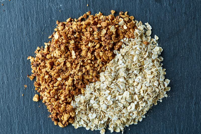 Healthy mix of granola and oatmeal on dark background, top view, close-up, selective focus royalty free stock images