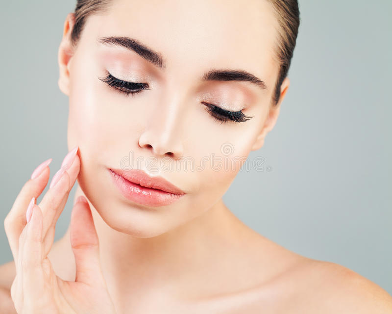 Healthy Model Woman with Skin touching her Hand her Face stock photography