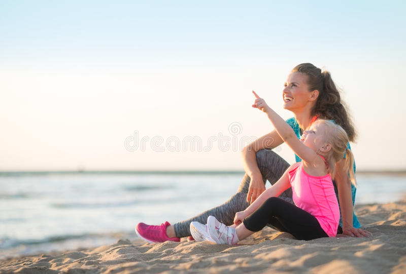 Healthy mother and baby girl on beach royalty free stock image