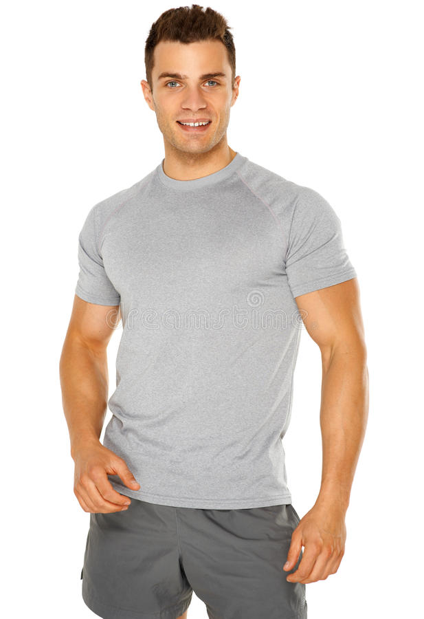 Healthy muscular young man isolated on white royalty free stock image