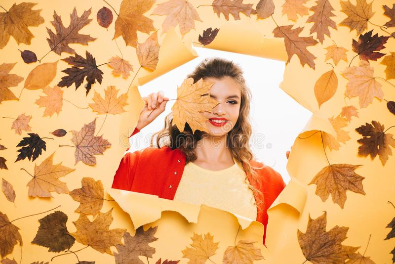 A healthy but natural glow. Fashion model with decorative fall makeup. Makeup trends for fall. Makeup girl peek through royalty free stock images