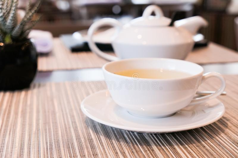 Green herbal tea in a restaurant, five o\'clock royalty free stock images