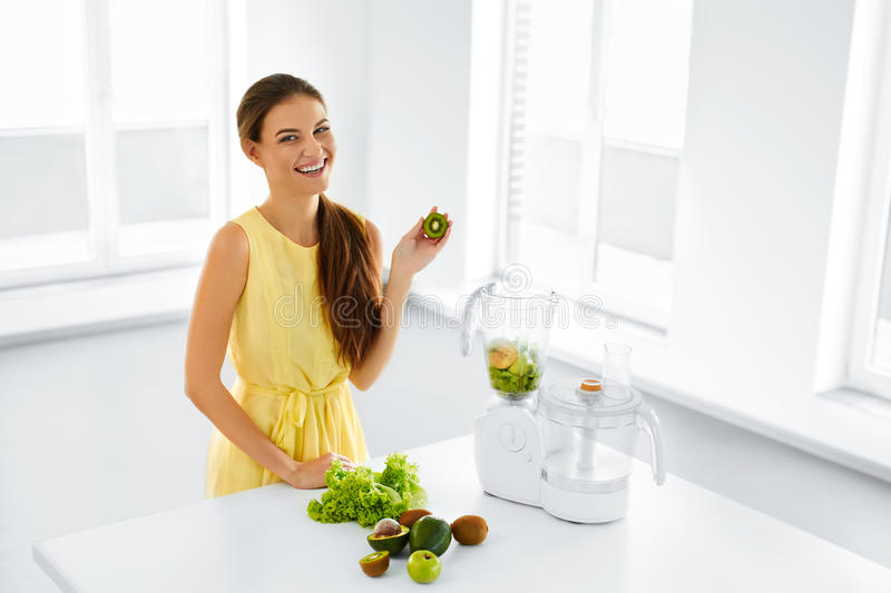 Healthy Nutrition. Woman With Detox Smoothie Juice. Diet Meal Ea. Healthy Nutrition. Closeup Of Smiling Young Woman With Blender Chopping Vegetables For Green royalty free stock photo
