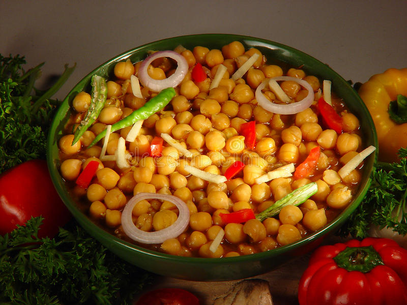 Healthy and nutritious chick peas salad. Healthy, steamed low fat and protein rich Nutritious Indian Chick peas salad served with chillies and onions and royalty free stock photo