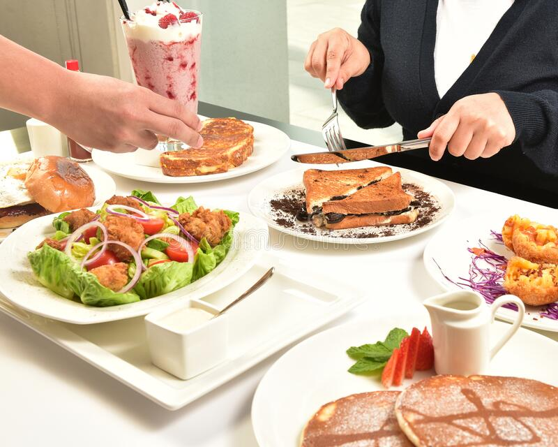 Healthy and Nutritious Food Consists of Vegetable, Fruits, Seafood. Healthy and Nutritious Food Consists of Vegetable, Pancake, Fruits, Chicken, Seafood, Loft stock photography