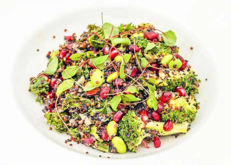 Healthy nutritious quinoa salad with fresh leaves and edamame. Quinoa and broccoli superfood healthy and nutritious salad perfect for spa eating and for stock photo