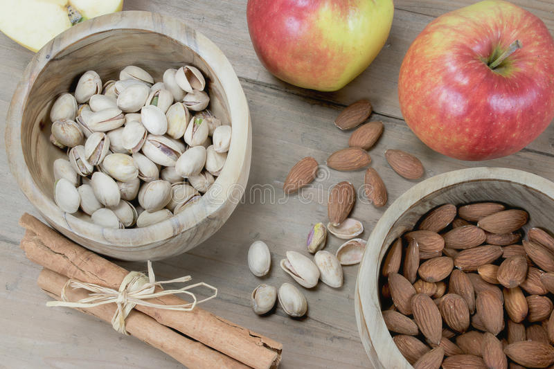Healthy nuts, spice and fruit on wooden table royalty free stock photo