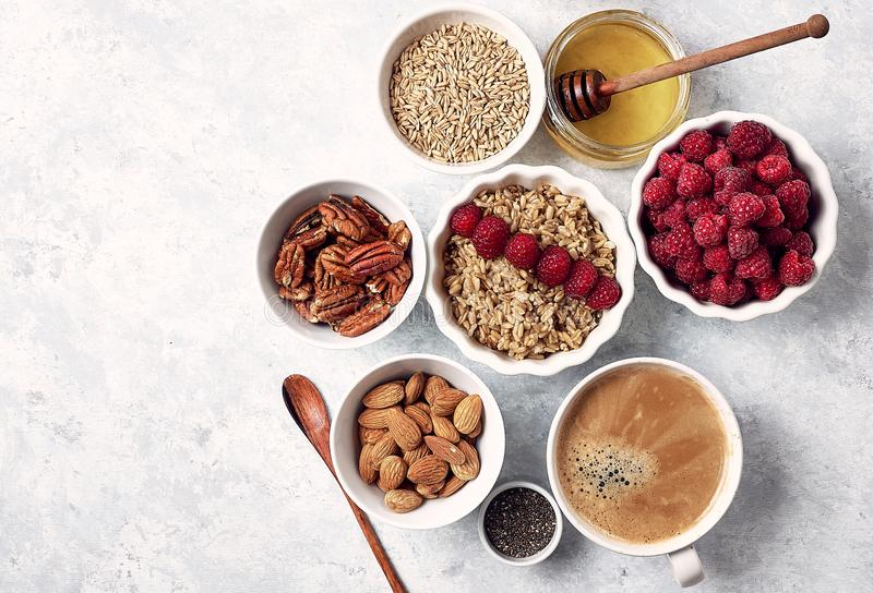 Healthy oatmeal breakfast with raspberries and finns, chia and flax seeds and honey, pattern, top visas, good morning royalty free stock image
