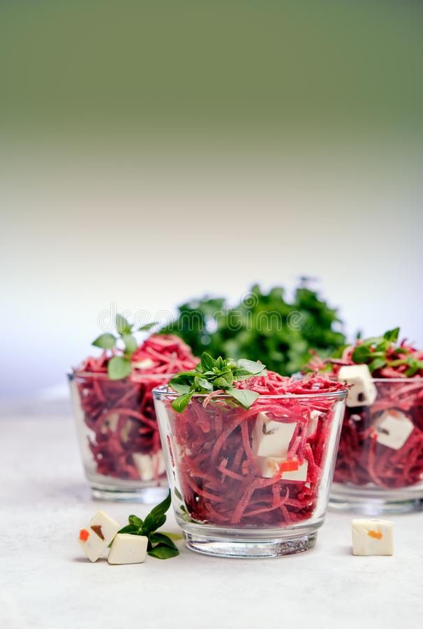 Healthy organic beet salad with greens royalty free stock photo