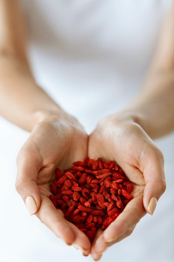 Healthy Organic Diet Food. Woman Hands Full Of Goji Berries royalty free stock photos