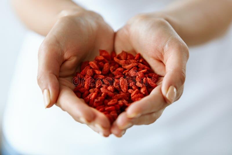 Healthy Organic Diet Food. Woman Hands Full Of Goji Berries stock images