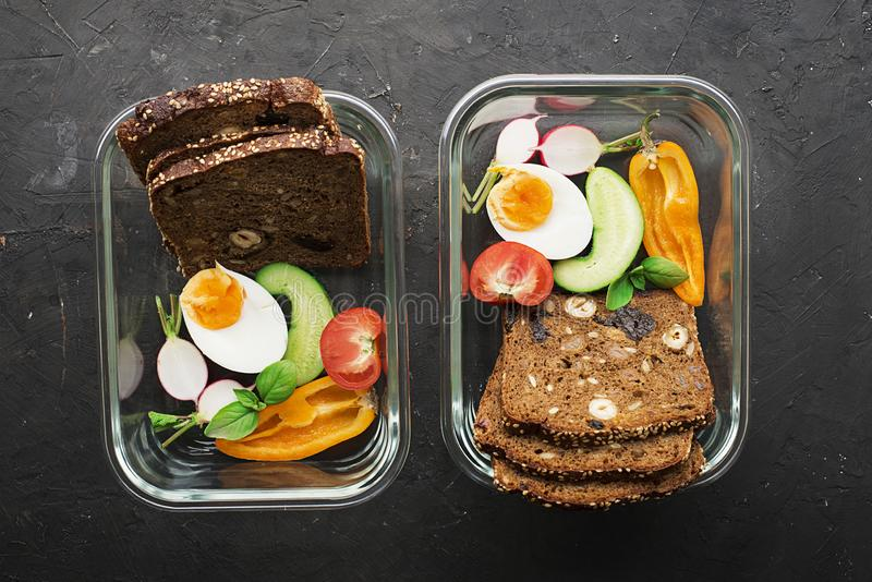 A healthy organic farm breakfast. Slices of cereal bread, cucumber, boiled egg, radish, berries, nuts, fruits, greens royalty free stock image