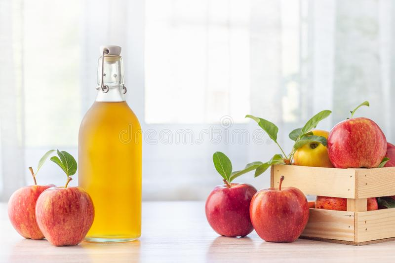 Healthy organic food. Apple cider vinegar in glass bottle. stock photo