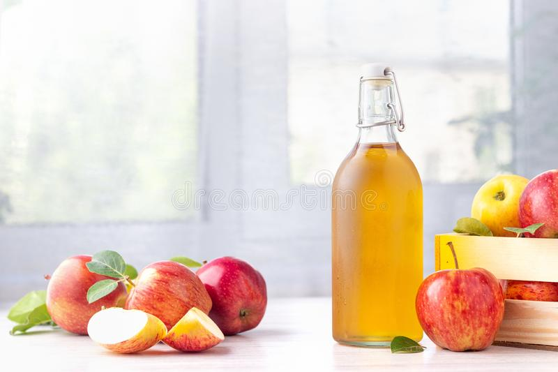Healthy organic food. Apple cider vinegar in glass bottle. royalty free stock photo