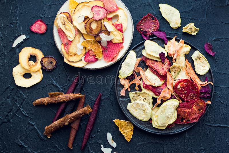 Healthy organic homemade fruit and vegetable chips royalty free stock images