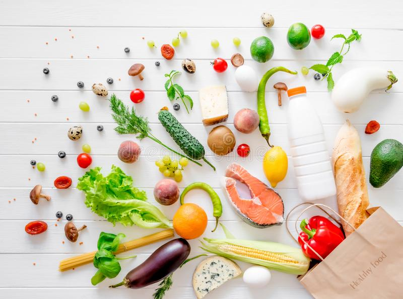 Healthy organic nutritious diet. Plenty of foods are taken off from the kraft package royalty free stock image