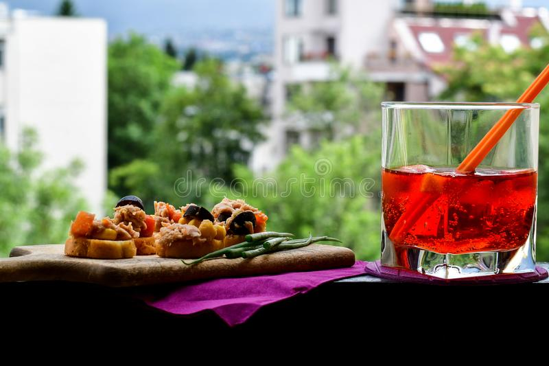 Aperol Spritz. Healthy organic sandwich with bruschetta,Sweet corn , carrots, black olives and fresh onion and grissini and Aperol Spritz stock images