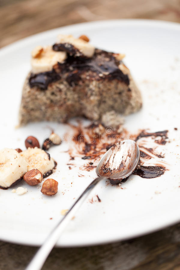Healthy paleo cake with dark chocolate, banana and hazelnuts royalty free stock images