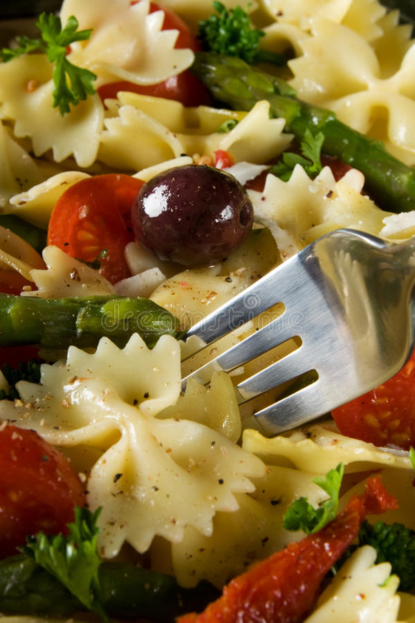 Healthy pasta meal. Healthy bow tie pasta with assorted vegetables royalty free stock photography