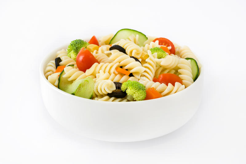 Healthy Pasta salad in a bowl isolated on white background royalty free stock image