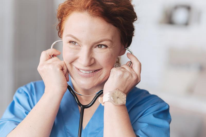 Portrait of beaming female doctor with stethoscope royalty free stock photos