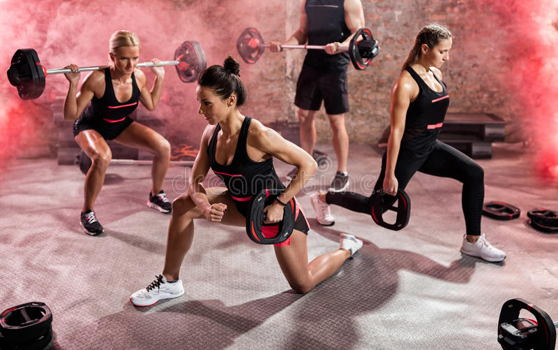 Healthy people doing exercise with weights stock photos