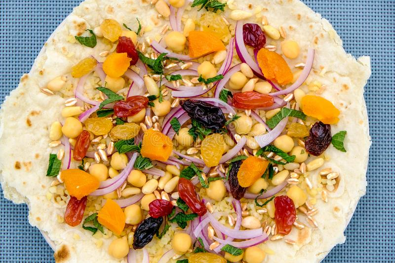 Healthy Pizza Base With Fruit and Nuts stock photography