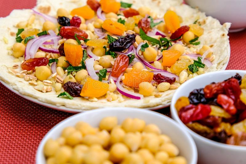 Healthy Pizza Base With Fruit and Nuts royalty free stock image