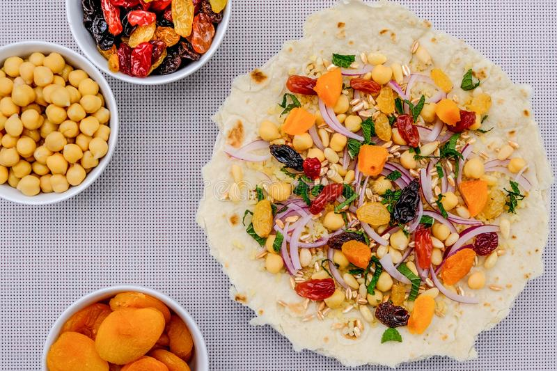 Healthy Pizza Base With Fruit and Nuts royalty free stock photo