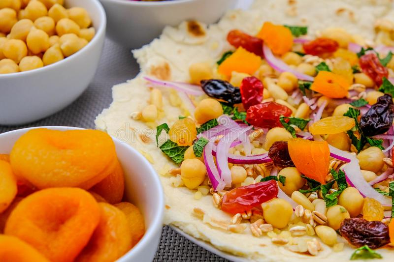 Healthy Pizza Base With Fruit and Nuts royalty free stock photography