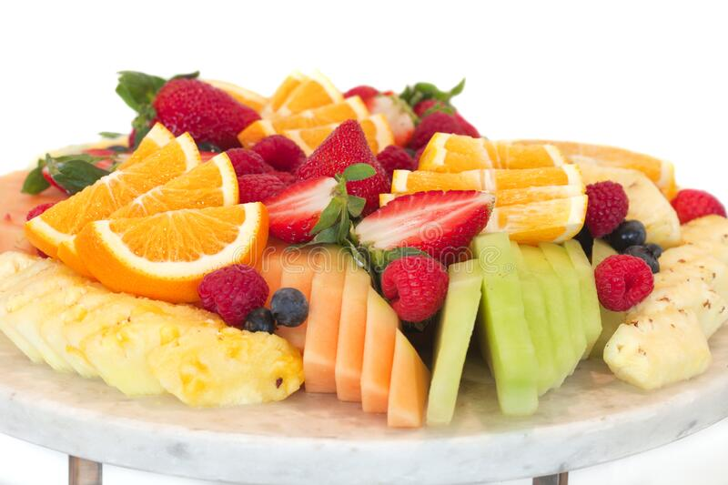 Healthy platter of different sliced fruits stock images