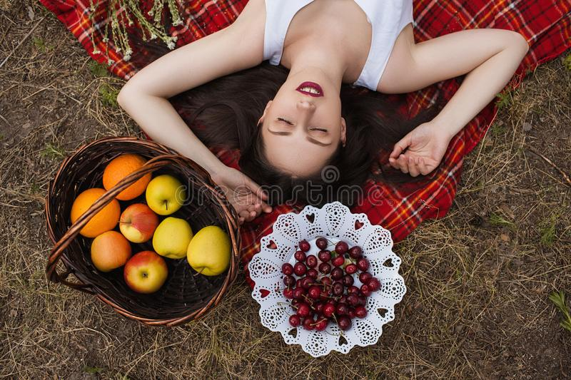 Healthy pretty woman nature picnic pelax concept. royalty free stock photos