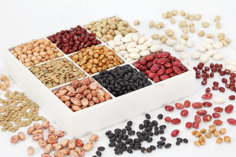 Healthy protein food. Kidney beans, assortment haricot - red, black, white, mung in square cells. Healthy protein food stock image