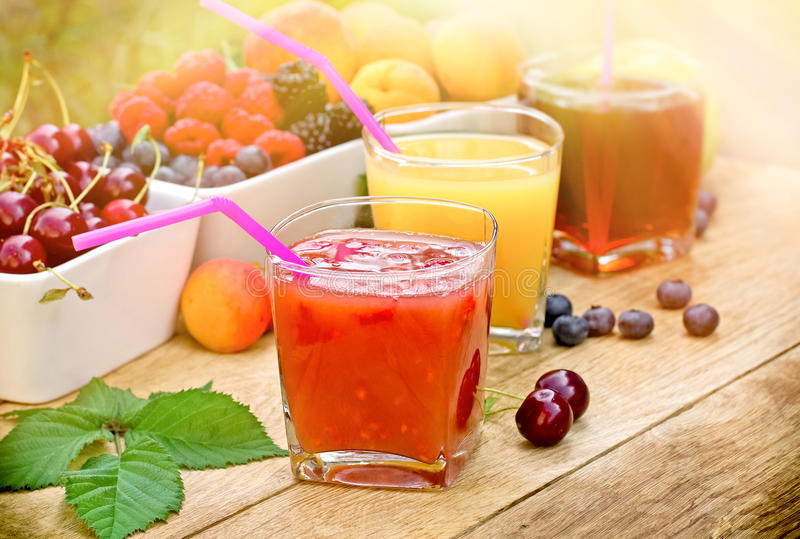 Healthy refreshing fruit drink - fruit juices. Healthy fruit juice made with organic fruits, juices and fruit on table stock photos
