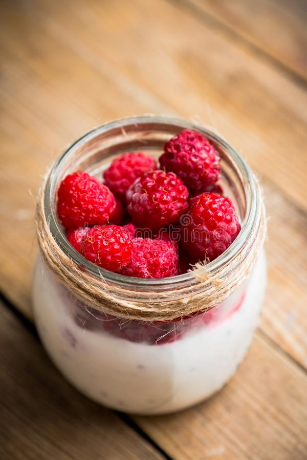 Healthy refreshment breakfast with yogurt, frozen raspberry and chia seeds royalty free stock image