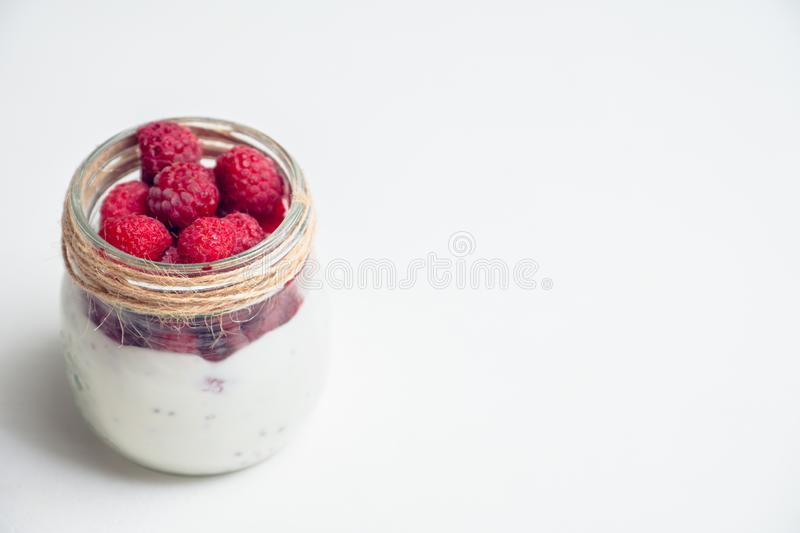 Healthy refreshment breakfast with yogurt, frozen raspberry and chia seeds royalty free stock photo