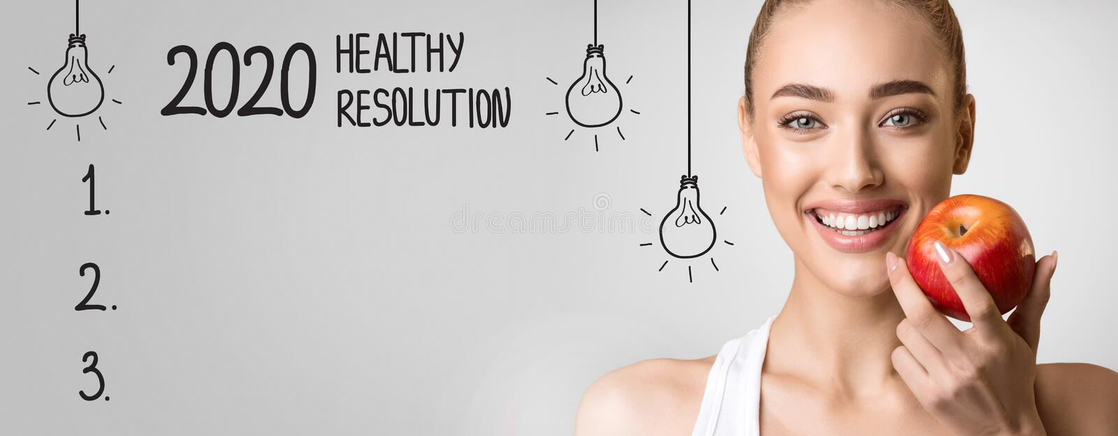 2020 Healthy Resolution with blank checklist and happy woman royalty free stock photo