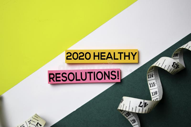 2020 Healthy Resolution! text on sticky notes with office desk concept stock photos