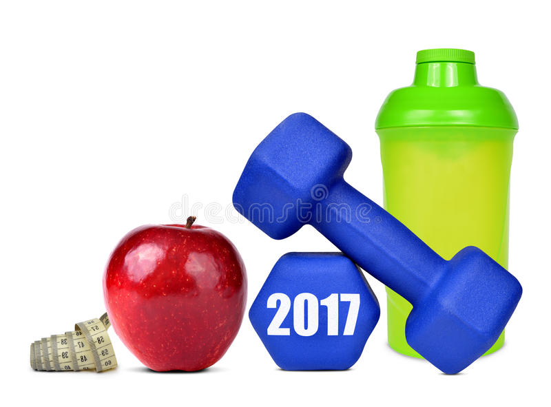Healthy resolutions for the New Year 2017. Red apple, dumbbells and protein shaker isolated on white. Healthy resolutions for the New Year 2017 royalty free stock image