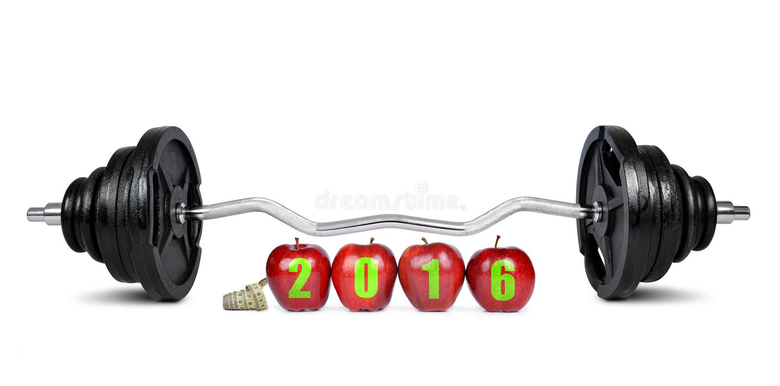 Healthy resolutions for the New Year 2016. Red apples with dumbbell. Healthy resolutions for the New Year 2016 stock photo