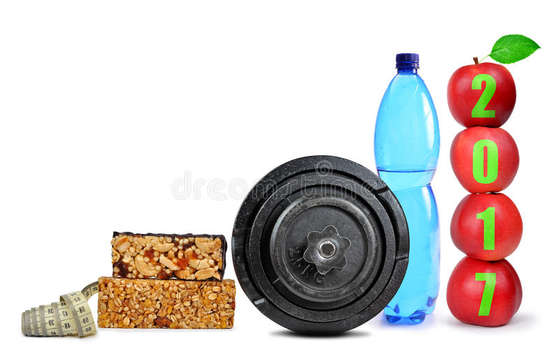 Healthy resolutions for the New Year 2017. Red apples, dumbbell and PET bottle with drinking water isolated on white. Healthy resolutions for the New Year 2017 royalty free stock photography