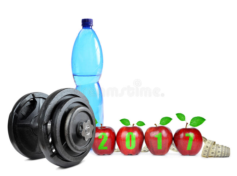 Healthy resolutions for the New Year 2017. Red apples, dumbbell and PET bottle with drinking water on white. Healthy resolutions for the New Year 2017 royalty free stock image