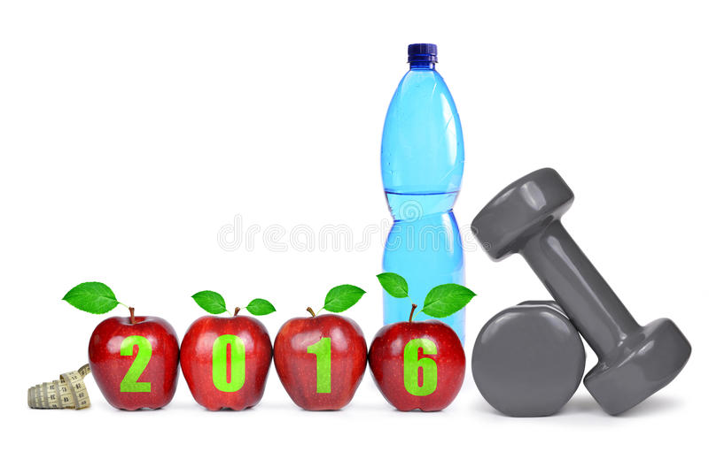 Healthy resolutions for the New Year 2016. Red apples, dumbbells and PET bottle with drinking water. Healthy resolutions for the New Year 2016 stock image