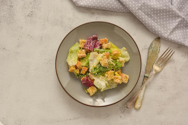 Healthy salad, caesar salad with croutons and dressing. Healthy foods stock photography