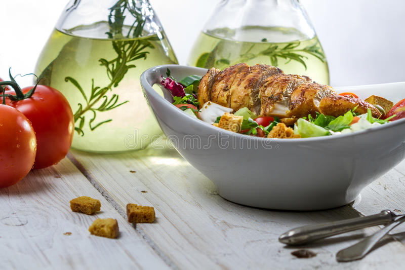 Healthy salad with chicken and ingredients stock images